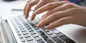 cropped-view-of-hands-typing-on-laptop_1262-3196.jpg